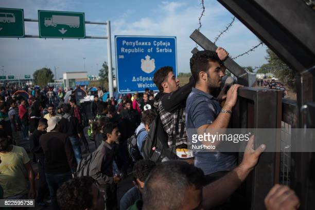 After a sudden border closure along the Balkan route migrants and refugees rioted and threw rocks at Hungarian border police who responded with...