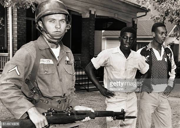 Three men from the mob around Little Rock's Central High School are driven from the area at bayonetpoint by these soldiers of the 101st Airborne...