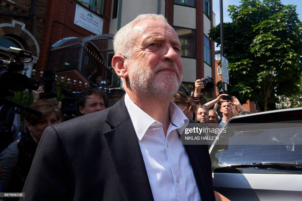 After a visit, Leader of Britain's opposition Labour Party, Jeremy Corbyn leaves Finsbury Park mosque in north London where a vehicle was driven into pedestrians, on June 19, 2017. Ten people were injured when a van drove into a crowd of Muslim worshippers near a mosque in London in the early hours of Monday, and a man who had been taken ill before the attack died at the scene. / AFP PHOTO / Niklas HALLE'N