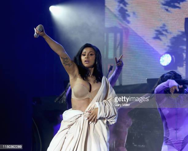 After a wardrobe malfunction Cardi B performs in a Palms Casino robe on day four of Bonnaroo Music And Arts Festival on June 16 2019 in Manchester...
