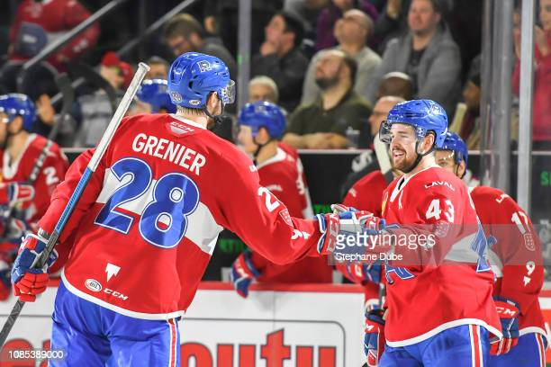 After Alexandre Grenier of the Laval Rocket scored his goal Xavier Ouellet of the Laval Rocket cheers him on against the Cleveland Monsters at Place...