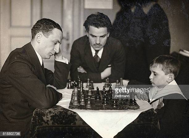 After an absence of over six months, Samuel Rzeschewski, the noted child chess prodigy and exhibition player, returned yesterday to New York, where,...