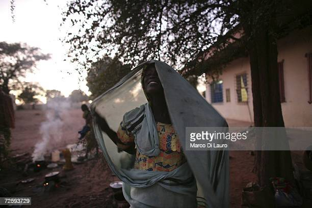After an attack on her village forced her to flee a Chadian village woman returns to the ground of the Hospital compound after visiting a relative in...