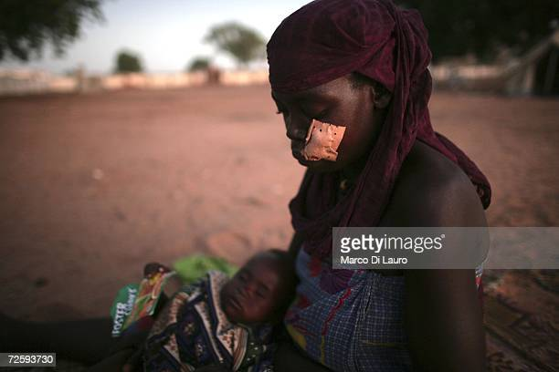 After an attack on her village forced her to flee a wounded Chadian village woman sits on the ground of the hospital November 17 2006 in a...