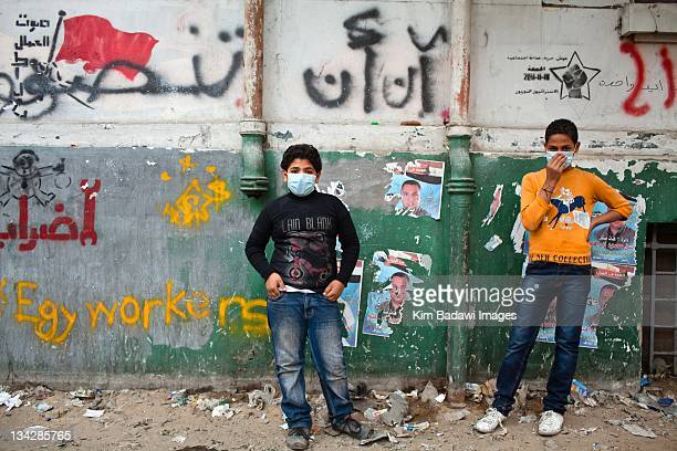 After an evening of street battles with Egyptian security forces and demonstrators children stand on Mohamed Mahmoud Street in downtown Cairo a...