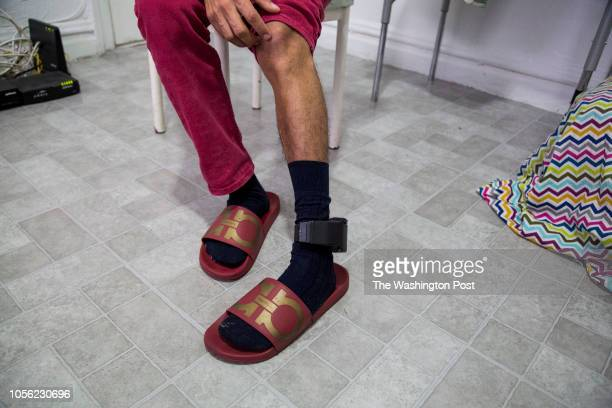 After an initial credible fear interview with immigration officials Misael was outfitted with an electronic ankle monitor seen here as he sits in...