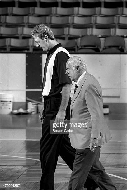 After announcing his retirement from the NBA Boston Celtics player Larry Bird takes a walk with Red Auerbach along the basketball court at Boston...