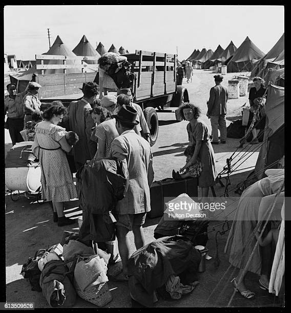 After arrival in Haifa new Jewish citizens wait for a ride to their new dwellings in a refugee camp or on a kibbutz As soon as space is available...