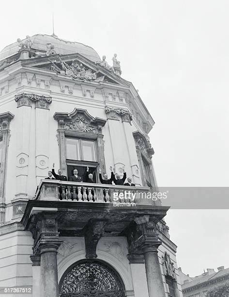 After Austrian Signing. Vienna, Austria: Waving from a balcony of Vienna's Belvedere Palace after signing of the Austrian State Treaty are : French...