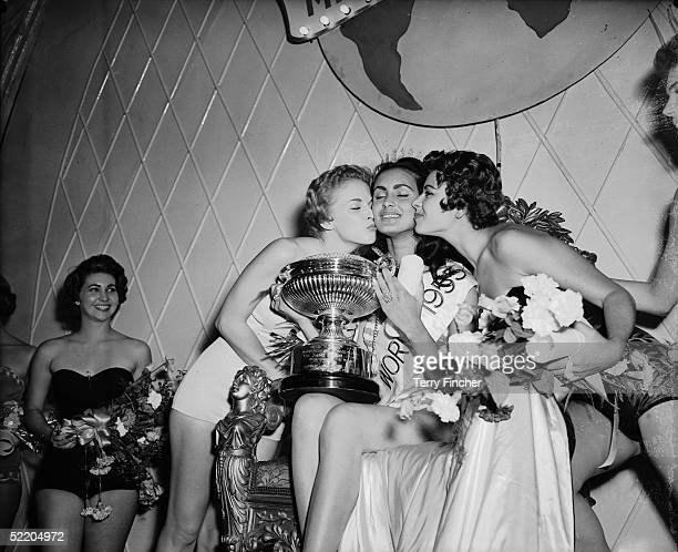 After becoming Miss World 1955 at the Lyceum Ballroom London Carmen Susana Duijm Zubillaga of Venezuela is congratulated by the runners up Margaret...