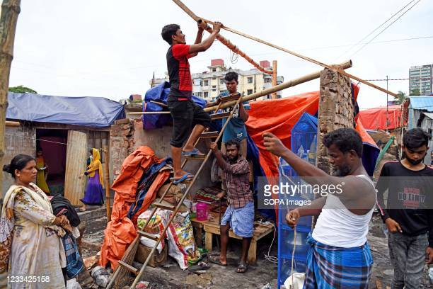 After being burnt in the massive fire accident, the slum dwellers are seen rebuilding their houses. According to World Bank, each year up to half a...