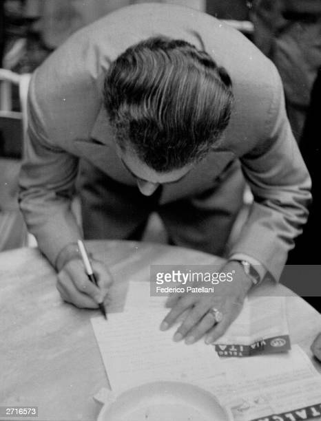 After being forced to flee to Rome Muhammad Reza Shah Pahlavi Shah of Iran signs the cable announcing his return to Iran Original Publication Picture...