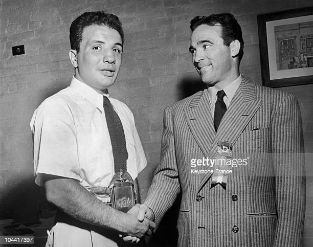 After being given their honor belts by the Mayor of New York rewarding their achievements on rings the two boxers Jake LA MOTTA and Marcel CERDAN...