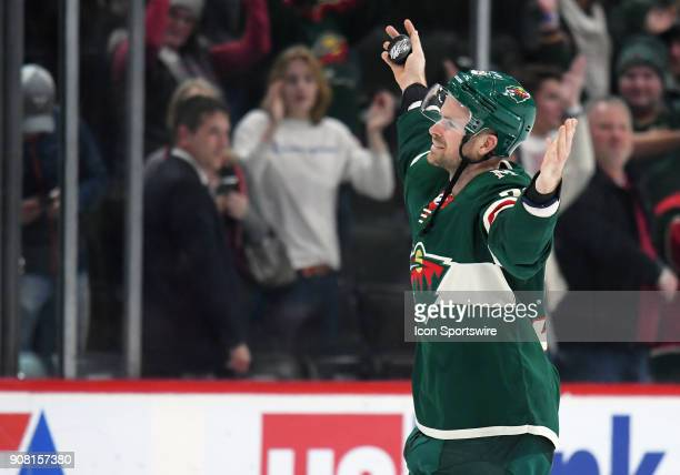 After being named 1st Star of the night Minnesota Wild Defenceman Nate Prosser leads the crowd in a Minnesota Vikings Skol Chant after a NHL game...