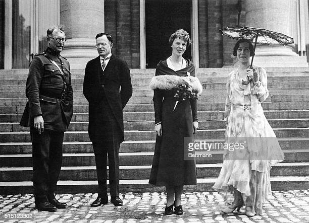 After being received in London and Paris after her flight across the Atlantic, Mrs. Amelia Earhart Putnam was greeted by the King and Queen of...