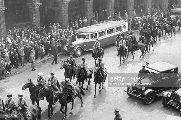 After being released from Ellis Island a group of mounted Cossacks parade down a New York street