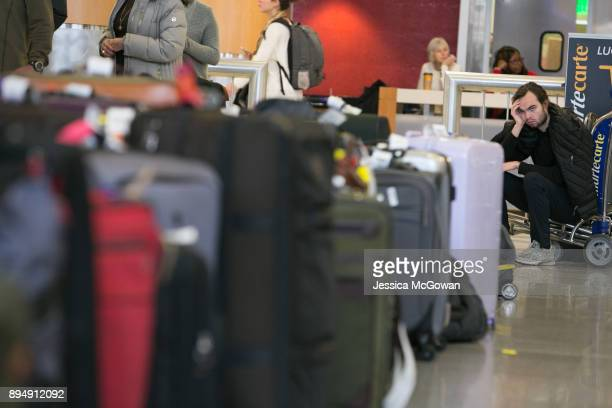 After being stranded in Atlanta during a layover Penn Ryan of Madison WI waits to find his luggage near rows of unclaimed baggage at...