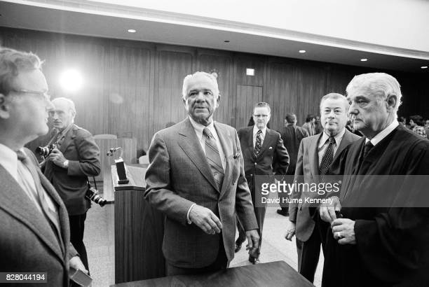 After being sworn in as Special Prosecutor Leon Jaworski and Federal Judge Byron Skelton speak wtith unidentified others on Capitol Hill Washington...