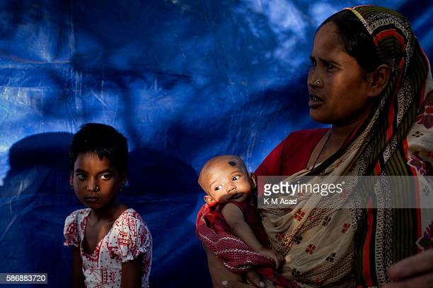 After being washout out by floodwater a woman with her new born baby take shelter in the railway track in Kurigram Bangladesh has been suffering from...