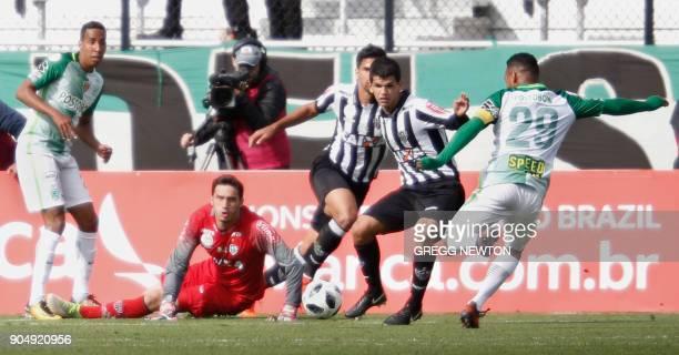 After blocking one kick goal keeper Cleiton of Brazilian club Atletico Mineiro looks on as Aldo Leao Ramirez of Colombian side Atletico Nacional...