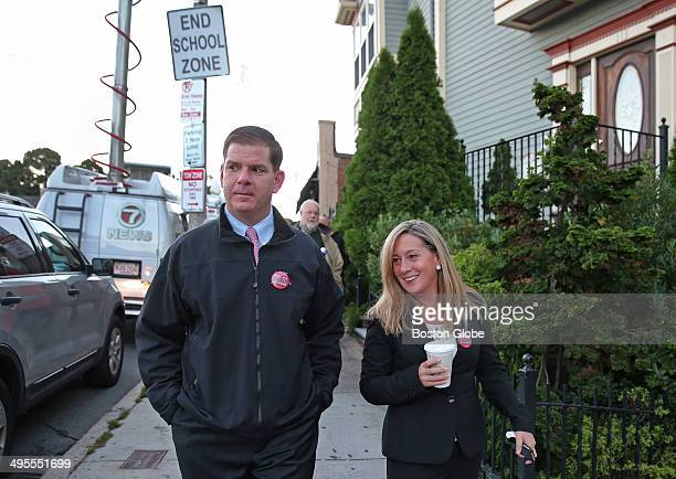 After Boston Mayoral primary Marty Walsh with long time partner Lorrie Higgins walk down Savin Hill Ave