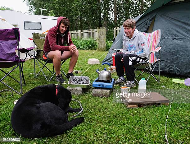 After camping out by the river people have food while they wait to watch rowers from across the country take part in the 183rd annual regatta on the...