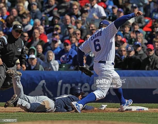 After catching a line drive, Bryan LaHair of the Chicago Cubs completes a double play by beating Norichika Aoki of the Milwaukee Brewers to first...