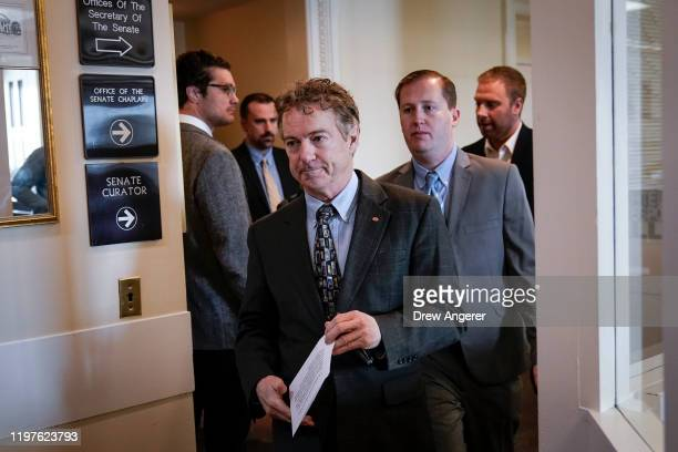 After Chief Justice John Roberts did not read his question aloud, Sen. Rand Paul leaves a brief news conference during the Senate impeachment trial...