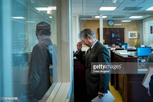 After Chief Justice John Roberts did not read his question aloud, Sen. Rand Paul arrives for a brief news conference during the Senate impeachment...