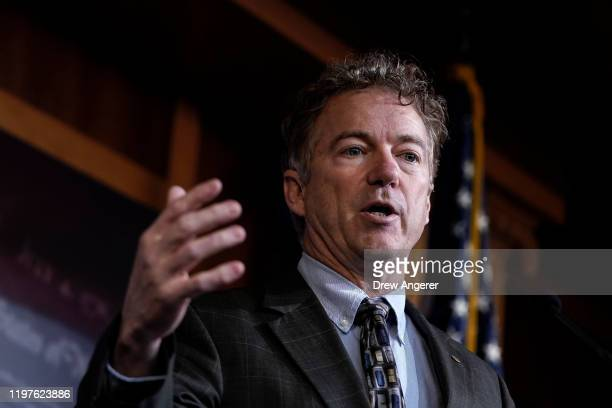 After Chief Justice John Roberts did not read his question aloud, Sen. Rand Paul speaks during a brief news conference during the Senate impeachment...
