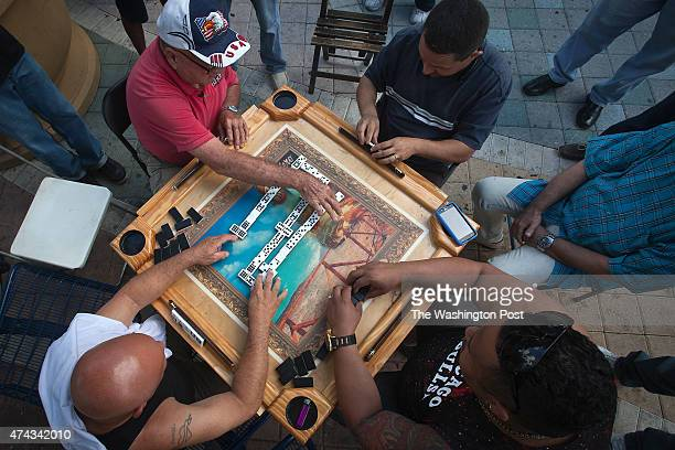 After closing time men play dominos outside Domino Park on SW 8th St in the Little Havana area of Miami on May 14 2015
