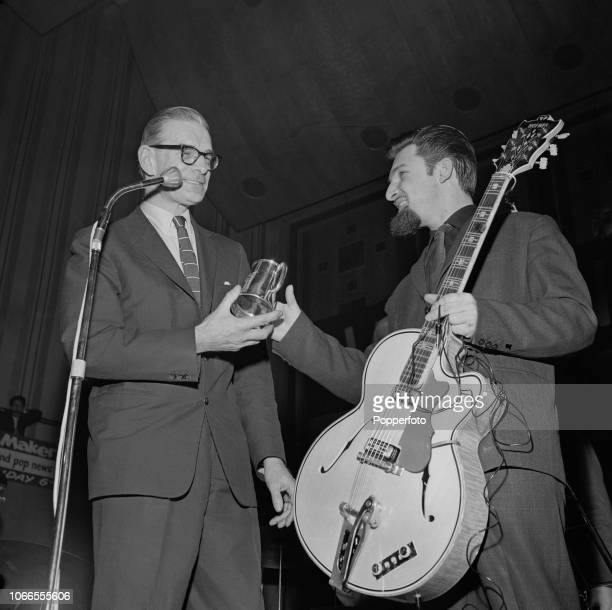 After coming top in a Melody Maker best guitarist poll Canadian born guitarist Diz Disley is presented with a tankard by Pat Brand on stage at the...