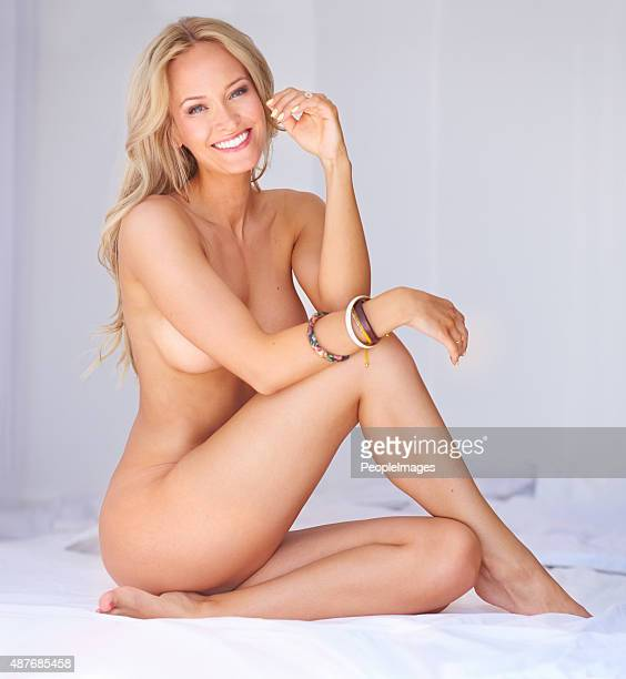 celebrate your body by relaxing in the nude - buxom blonde stock photos and pictures
