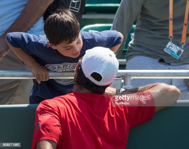 After defeating Thanasi Kokkinakis Fernando Verdasco from Spain changed a ball for a kiss with a kid at the Grand Stand Stadium of the Miami Open in...