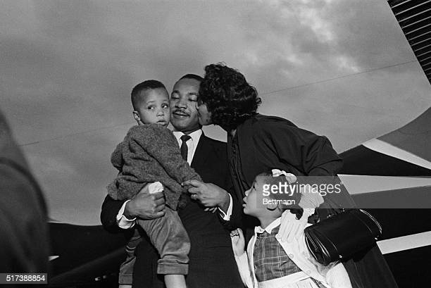 After Dr Martin Luther King Jr is freed from jail under a $2000 appeal bond he is greeted by his wife Coretta and children Marty and Yoki at the...