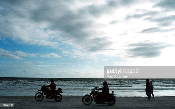 After driving all night to attend the 61st annual Bike Week, Gary Johns and Brad Casey, both of Rome, GA cruise along the beach March 1, 2002 in...