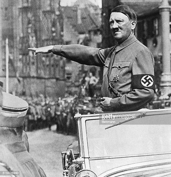 After driving to the Zeppelin Field at Nuremberg Hitler stood in his automobile at the Adolf Hitler Platz giving the Nazi salute for five hours...