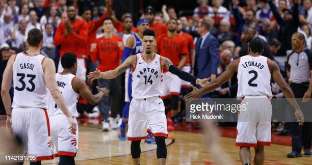 After dropping a three pointer and then a time out on the floor Toronto Raptors guard Danny Green greets his mates as they head to the bench Toronto...