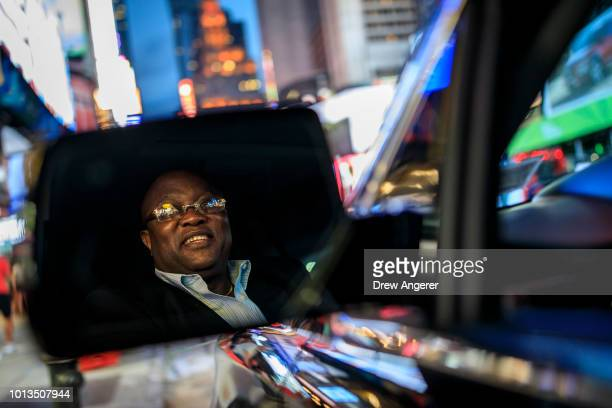 After dropping off passengers at a Broadway play Johan Nijman a forhire driver who runs his own service and also drives for Uber on the side poses...