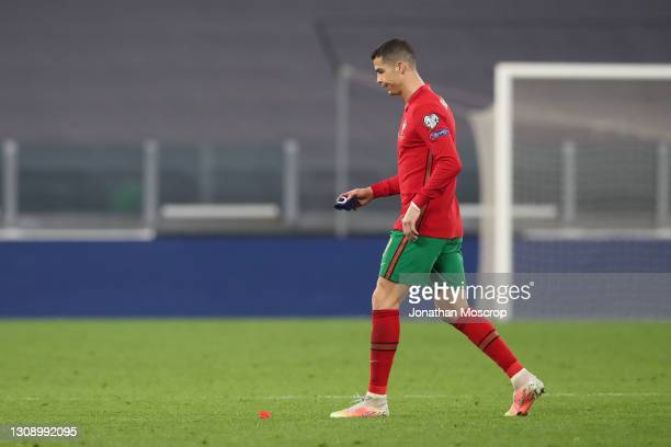After failing to impress Cristiano Ronaldo of Portugal with his captain's armband in hand dejectedly leaves the field of play following the final...