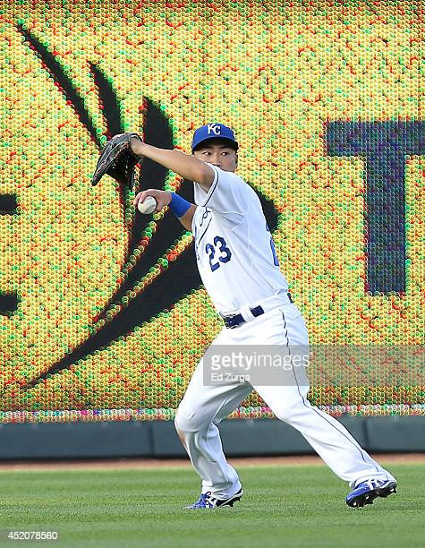 After fielding a ball hit by Alex Avila of the Detroit Tigers, Norichika Aoki of the Kansas City Royals throws the ball to his cut off man in the...