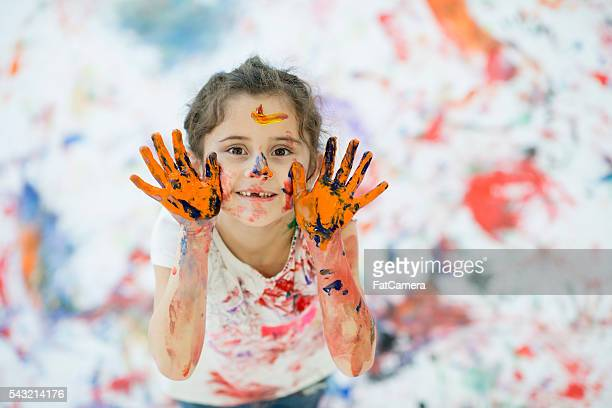 After Finger Painting a Canvas