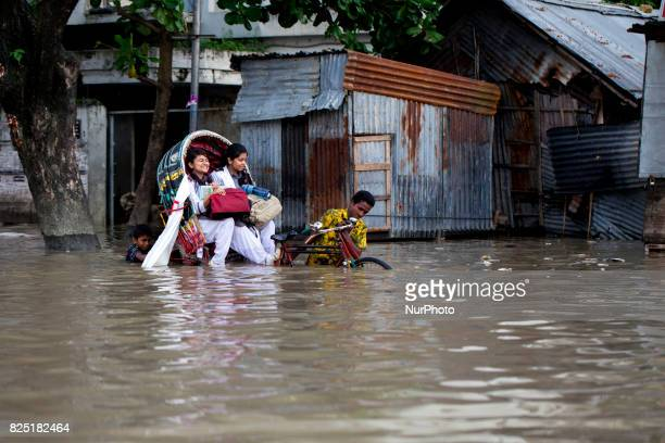 After finished school student going their home at water logging area July 26 2017 Chittagong Bangladesh Every day the Chittagong city is facing...