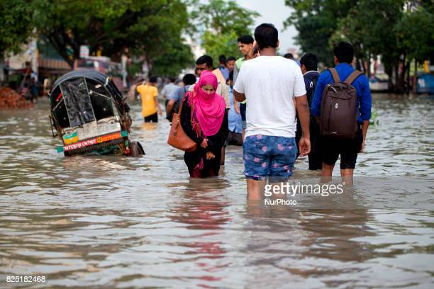 After finished work people going their home in water logging area July 26 2017 Chittagong Bangladesh Every day the Chittagong city is facing...