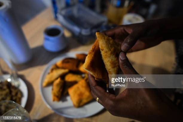 After finishing Maghrib prayer, Ifrah Ahmed, a Somali-Irish living in Dublin, eating Somali food including Mandazi and Sambusa , on the second day of...