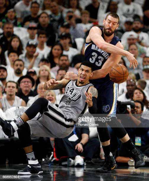 After grabbing a rebound Danny Green of the San Antonio Spurs is fouled by Marc Gasol of the Memphis Grizzlies in Game One of the Western Conference...