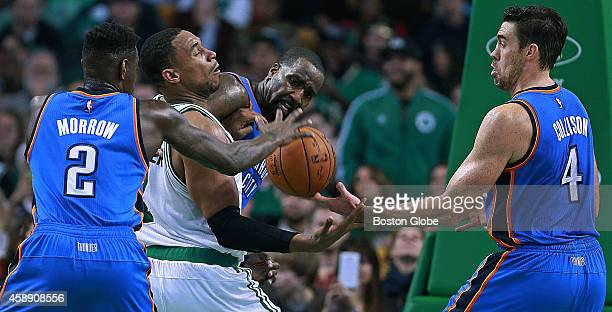 After having a fourth quarter shot blocked by the Thunder's Kendrick Perkins the Celtics Jared Sullinger finds himself surrounded by Thunder players...