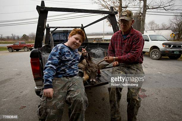 After having a Vermont state wildlife biologist not shown note the data from a recently shot whitetail deer Perle Webb Sr right and his grandson hold...