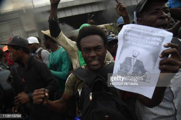 After having burned a US flag protesters chants Long live Putin down with the Americans in the Haitian Capital PortauPrince February 15 on the nineth...