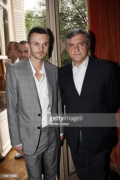 After Heidi Slimanenew designer Chris Von Aschposing with Sidney Toledano at the Dior Fashion show during Paris Menswear Fashion Week SpringSummer...